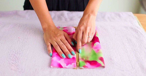 She Folds The Colorful Fabric In Half. The End Result? A Lovely Item That Everyone Must Have