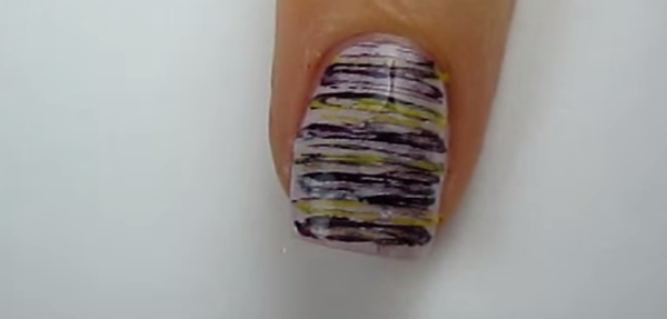 She Presses Dental Floss Across Her Nail. When Shes Done. It Look Incredibly Cool