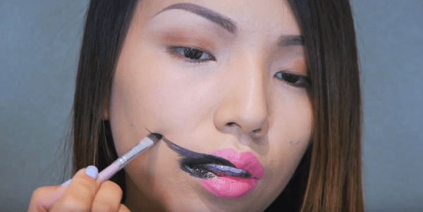 She Begins To Draw A Black Line Across Her Cheek.The End Result? Fantastic!