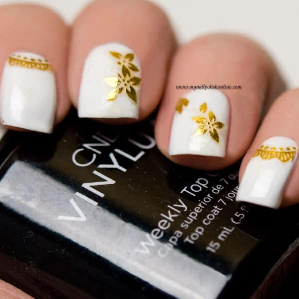 Interesting Nails Art Designs Inspired From Christmas And New Year's Eve