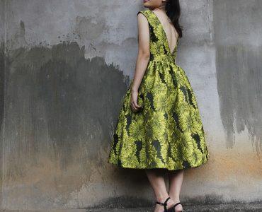 wearing a dress.